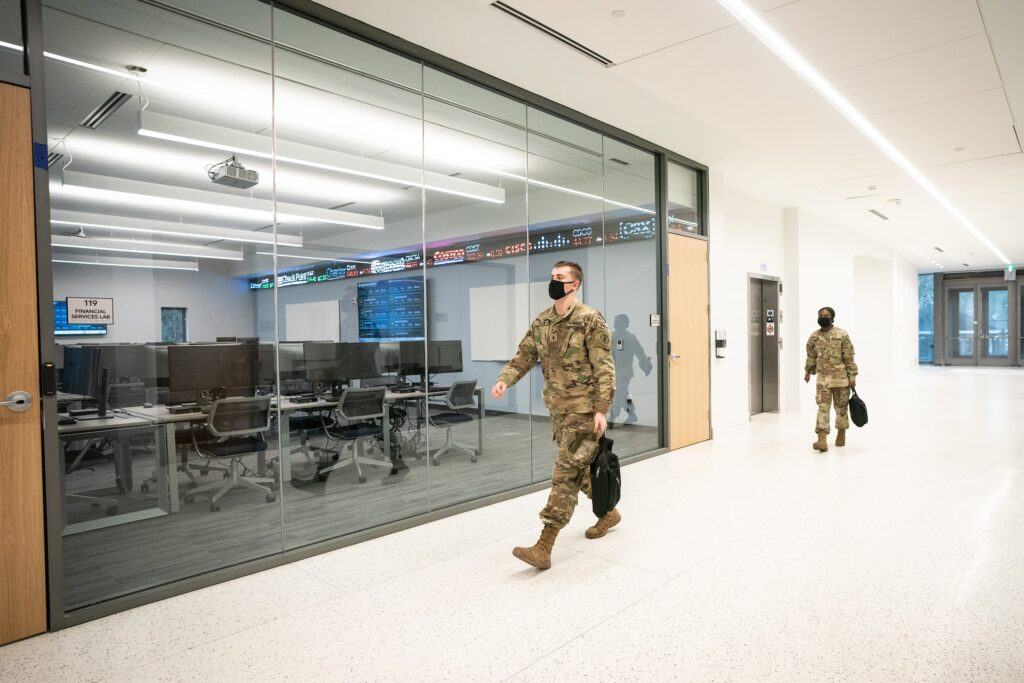 Cadet walking in front of Financial Lab