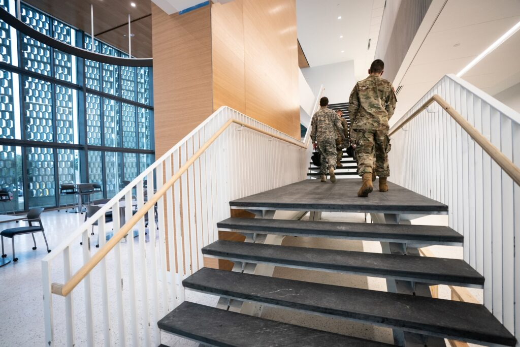 Cadets walking up stairs in Bastin Hall