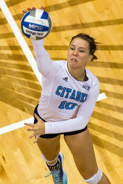 Citadel volleyball player spiking ball in the air