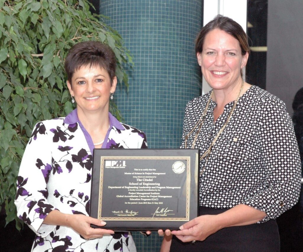 Dr. Tracey Richards presenting the MSPM accreditation plaque to Dr. Connie Book